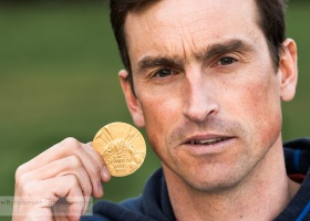 Kenton Cool with 1924 Olympic Gold Medal of Dr Arthur Wakefield. Photography by Vitty Robinson